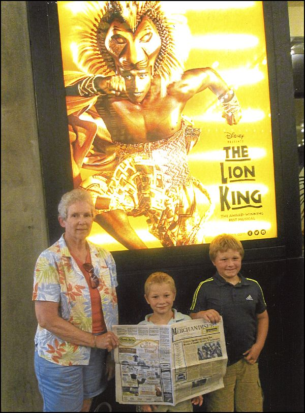 Eileen Zerbe And Her Grandchildren Austin And Gavin Enjoy Reading The Merchandiser While In Nyc To See The Lion King Submit Lion King Photo Contest Reading