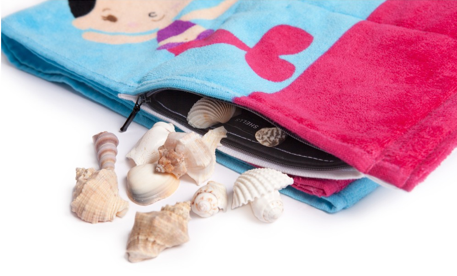 Towelmate beach towels for kids or adults with a built in zipper compartment. Genius!