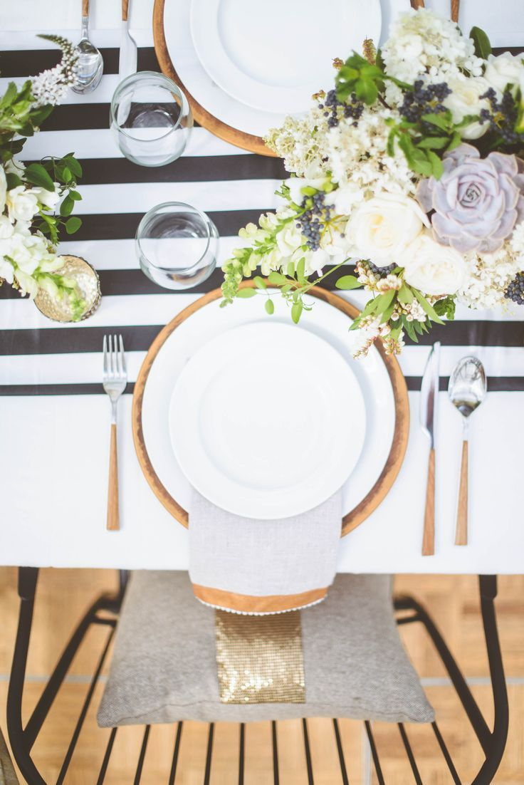 Black and white stripe charger plates - Gold Plates And Cutlery Over A Black And White Table Runner
