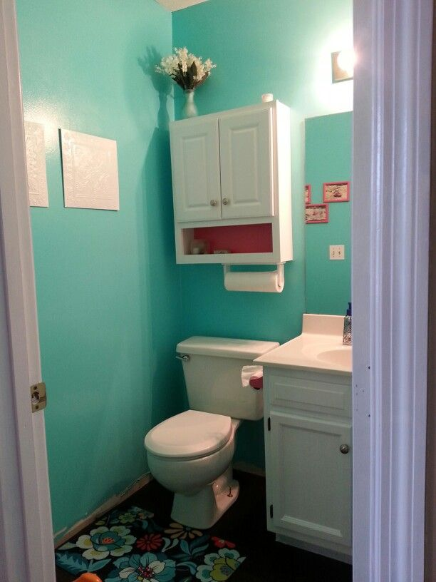 Aqua Bathroom With Pink And White Accents.
