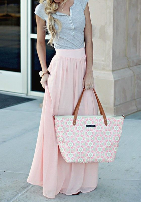 Beautiful red maxi skirt with a white blouse. Pink maxi skirt with a designer patterned white sweater. A nice hat to go with the outfit! Black maxi skirt with a white t-shirt tied in a knot on the front.
