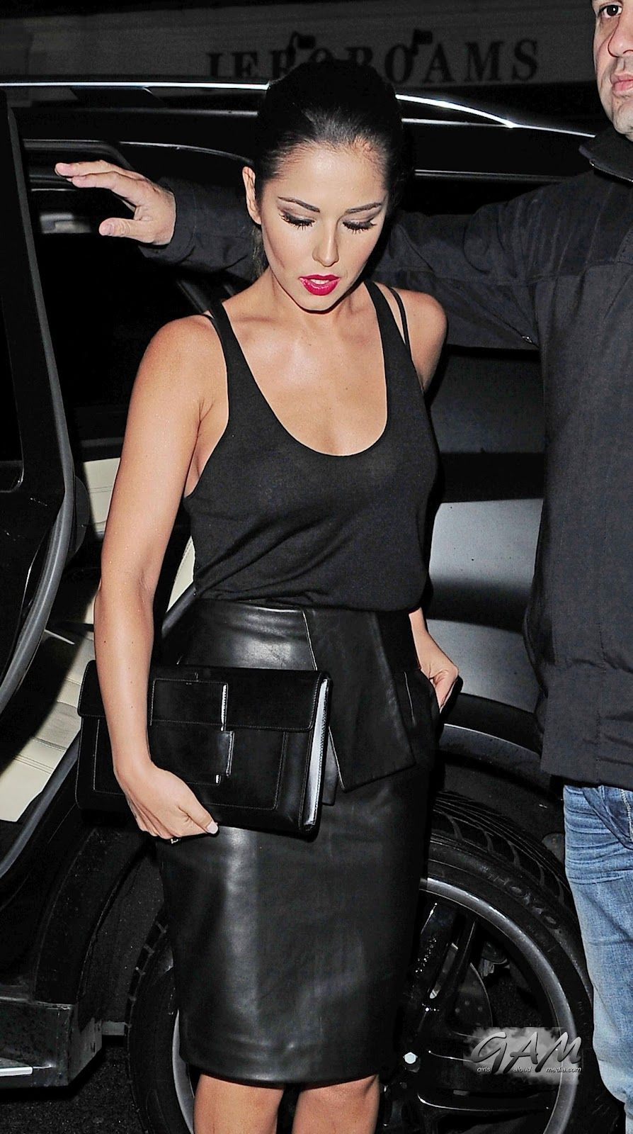Cheryl Cole dons flimsy vest and tight leather skirt as she and ...