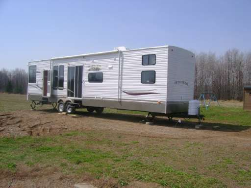 Check out this 2011 Heartland Country Ridge 41RBQB listing