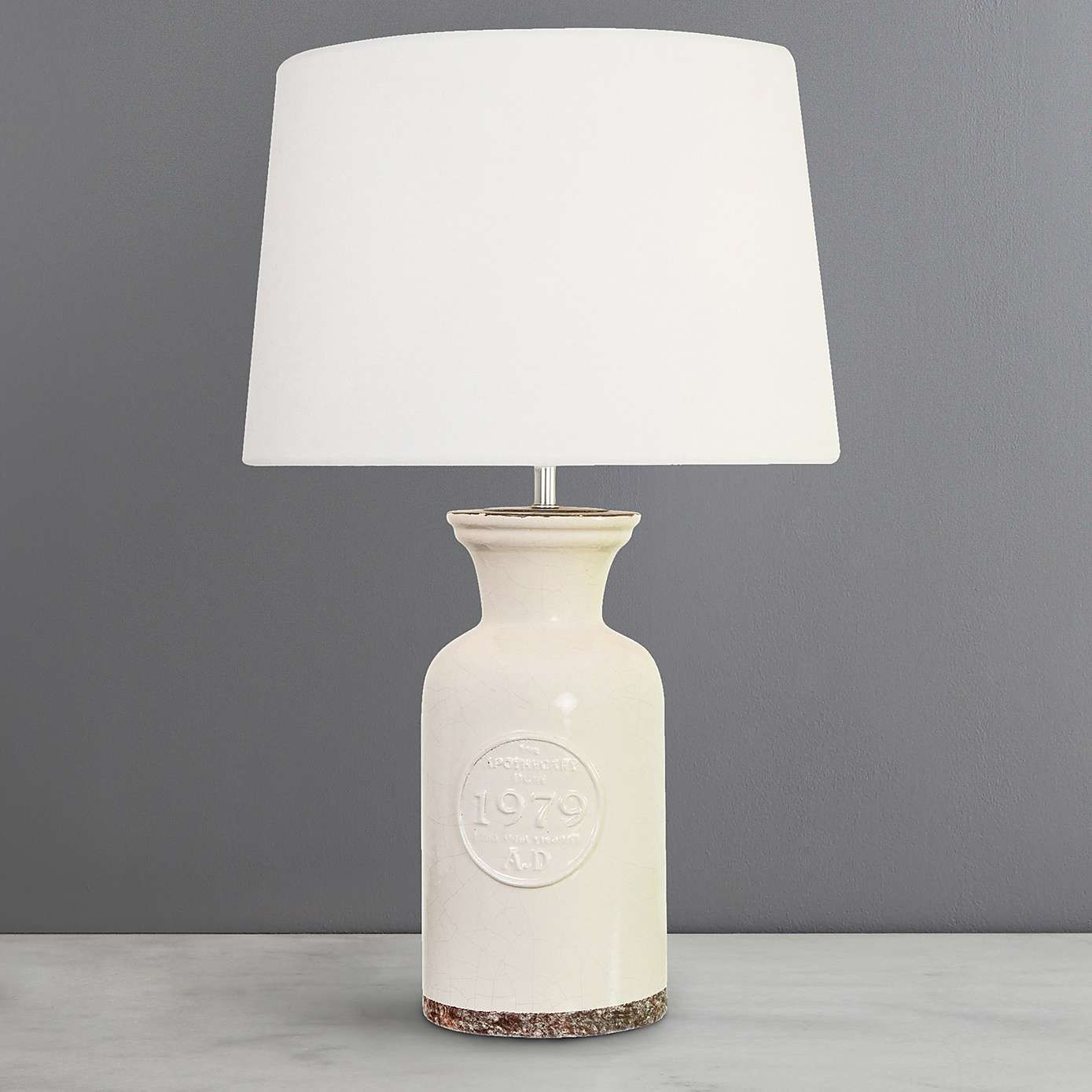 Porter ceramic table lamp cream dunelm lounge pinterest crafted with a cream ceramic bottle shaped base that features an embossed motif this handmade table lamp is completed with a plain faux linen shade geotapseo Choice Image