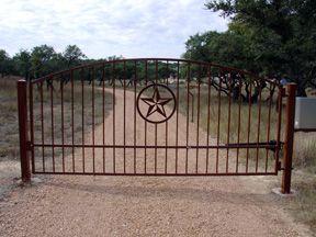 Custom iron driveway gates texas, custom ranch gate texas, custom metal driveway gate texas.