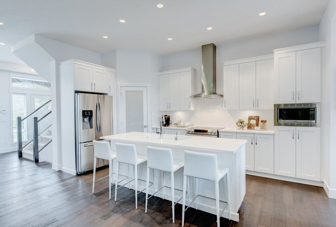 Bright All White Kitchen With Quartz Countertops And Spacious Pantries At Edgewood Trendy Kitchen Tile Kitchen Cabinets Painted Grey Stained Kitchen Cabinets