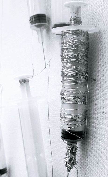 Safâa Erruas | Seams Skin, 2010 | Syringes and different materials on the wall