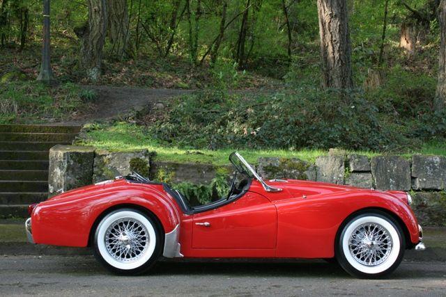 8  1958 Triumph TR3 - Red - White top/tonneau - black