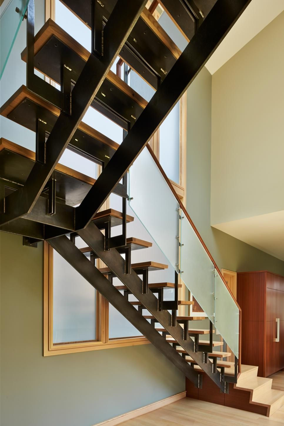 Design Floating Steps a floating staircase with black metal base frosted glass railing and wood steps