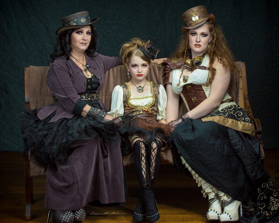 Clients Lisa, Riley, and Kristen Boyles MUAH Rhoda Cronebach and Rachel Cronebach Wardrobe Stylist Gail Beck Jewelry Victorian Magpie (Left) Leather Hat and Bracer FantasyFuzion Boots Hades UK — with Rachel Cronebach, Rhoda Cronebach, Gail Beck, Dave Boyles, Lisa J Boyles, Kristen Boyles, Victorian Magpie and Hades UK at DeBence Antique Music World.