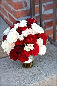 burgundy and white rose bouquet wrapped in white silk