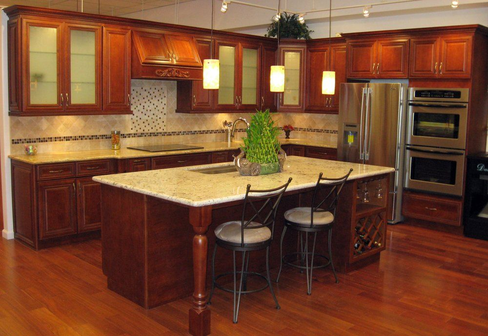 Sycamore Cherry Cabinets With Giallo Regal Granite Counters And An Island  Done In Crystal White Granite