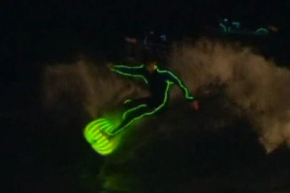 A group of surfers lit up the waves at Bondi Beach in Sydney as they took to their luminous boards in neon wetsuits to welcome the Australian summer.