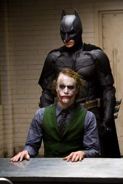 """CHRISTIAN BALE stars as Batman and HEATH LEDGER stars as The Joker in Warner Bros. Pictures' and Legendary Pictures' action drama """"The Dark Knight,"""" distributed by Warner Bros. Pictures and also starring Michael Caine, Gary Oldman, Aaron Eckhart, Maggie Gyllenhaal and Morgan Freeman."""