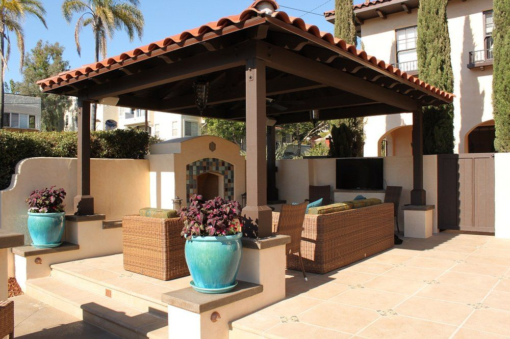 Outdoor fireplaces san diego google search backyard for Spanish outdoor kitchen designs