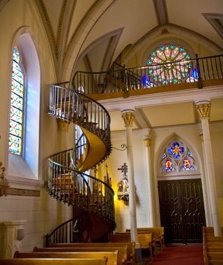 """The """"miracle staircase"""", Loretto Chapel, Santa Fe, NM. The spiral staircase was built in the 1800s and has no supports and no nails. How it was constructed, and by whom, is unknown. It's really remarkable to see in person."""