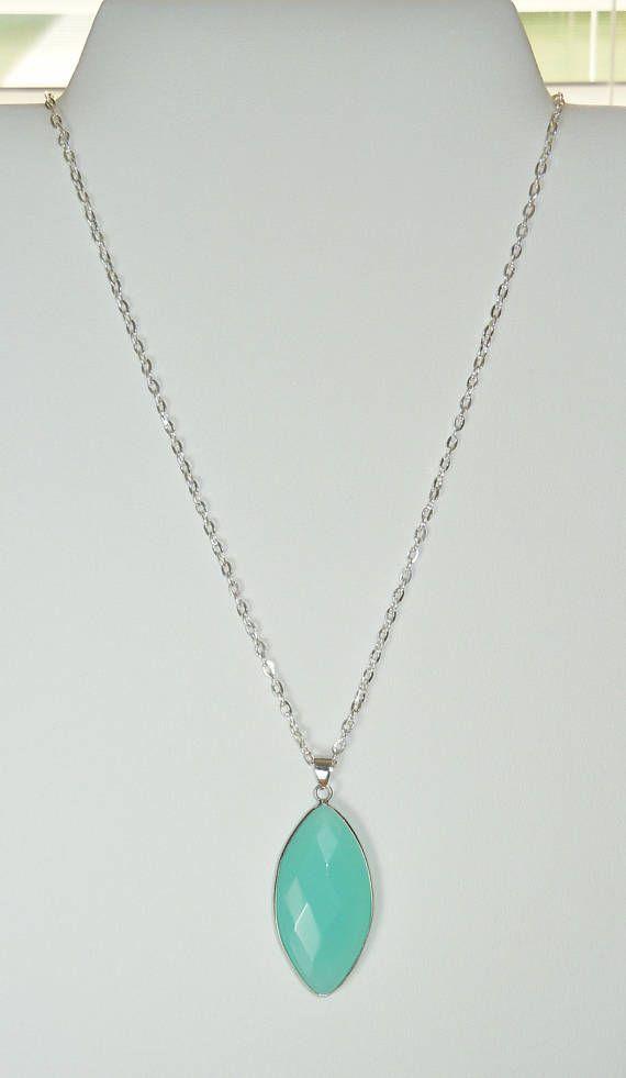 Beautiful beachy turquoise blue stone pendant on silver chain beautiful beachy turquoise blue stone pendant on silver chain aloadofball Image collections