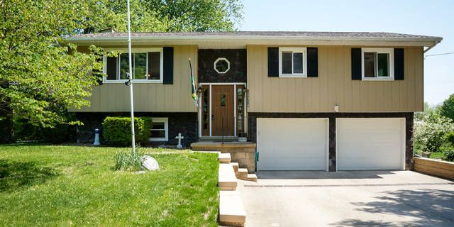 *100% NO DOWN PAYMENT FINANCING*EXTRA 2 CAR GARAGE!*BRAND NEW CARPET THROUGHOUT*  WHAT A FIND! THIS 3 BEDROOM, 1.5 BATH HOME BOASTS AN ATTACHED 2 CAR GARAGE PLUS AN EXTRA DETACHED 2 CAR GARAGE (INSULATED, HEATED,