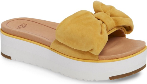 588509adef2 Ugg Joan Platform Sandal in Yellow. An oversized bow graces the top ...