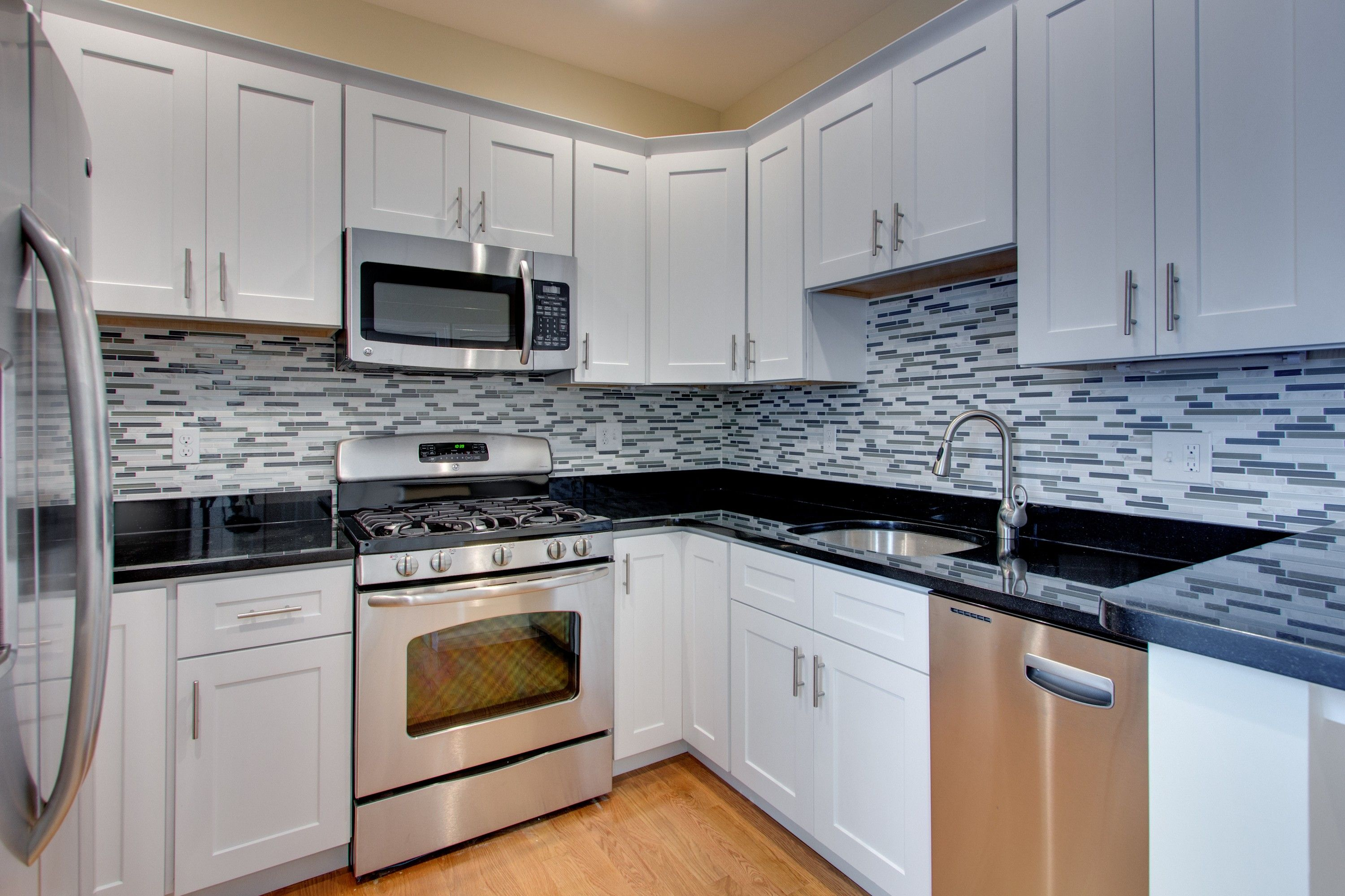 luxury shaker white kitchen cabinets feat black granite countertop