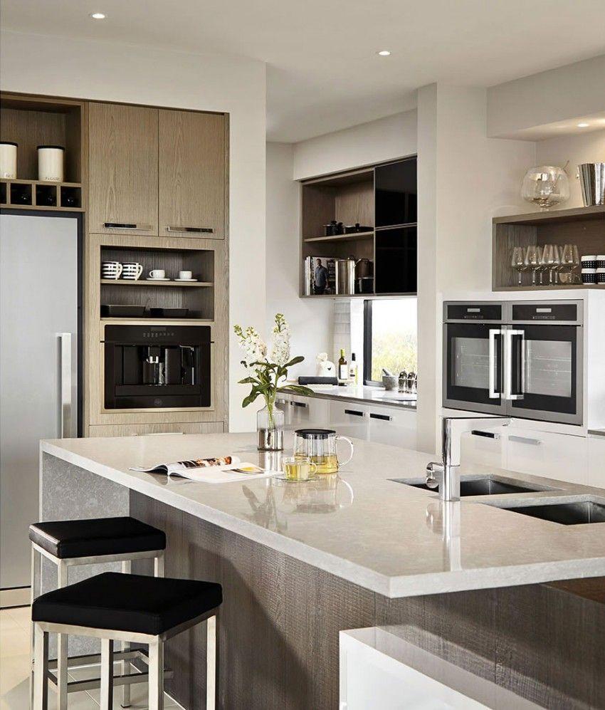 Casa de dos pisos moderna con hermosa fachada estilizada for Modelos de pisos de cocina