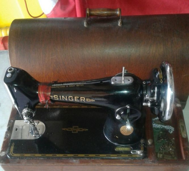 Singer 201. Needs a motor or handcrank attachment. Looks like a bargain!