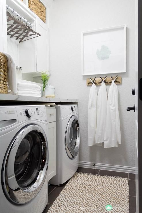 White And Gray Laundry Room Features Walls Painted Light