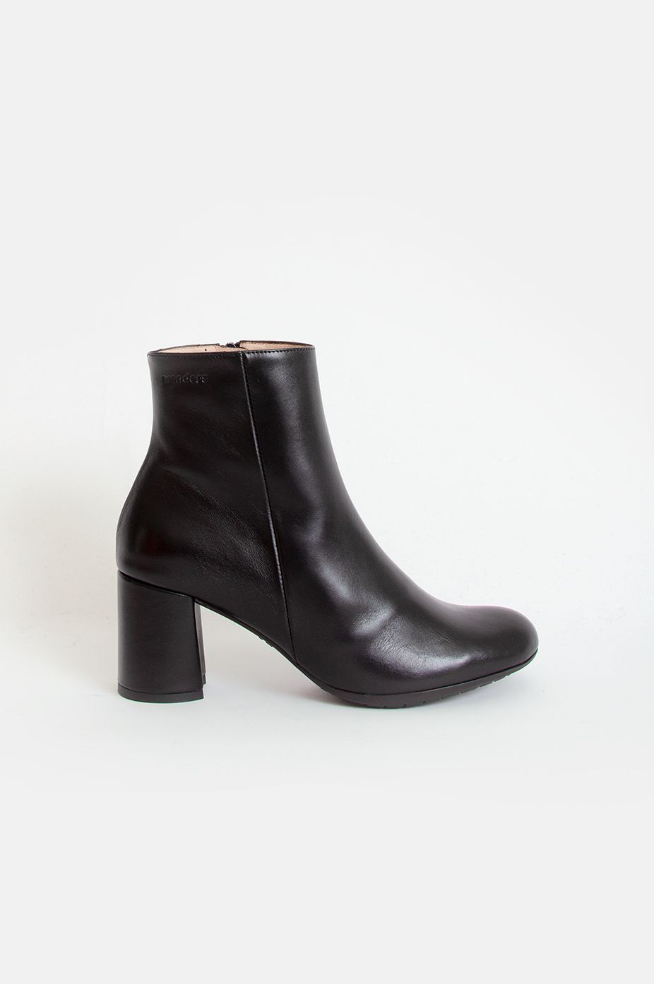3d289e897398 Wonders s ankle boots have been expertly crafted from butter-smooth leather  in timeless black.