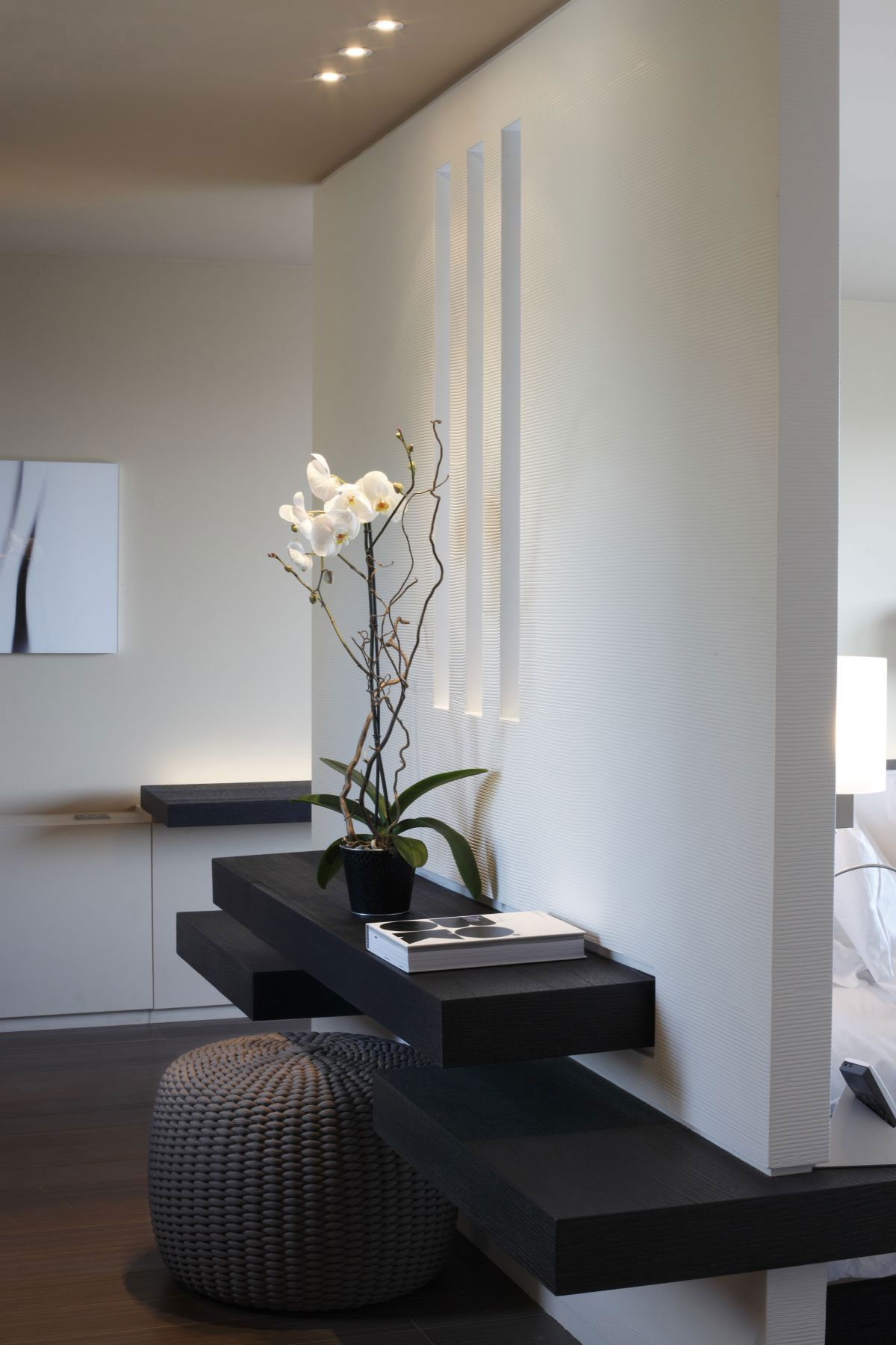 single wall shelf would work beautifully as an entry table with the right spot lighting and orchid anyway la rserve hotel in ramatuelle by jean michel