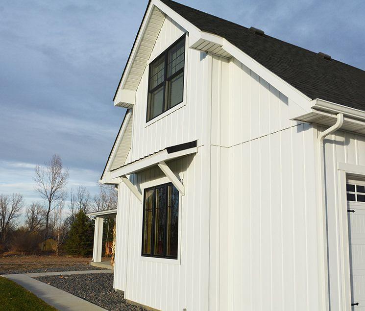 White Board And Batten Siding Trulog Maintenance Free Siding In 2020 Board And Batten Siding Board And Batten Modern Farmhouse Exterior
