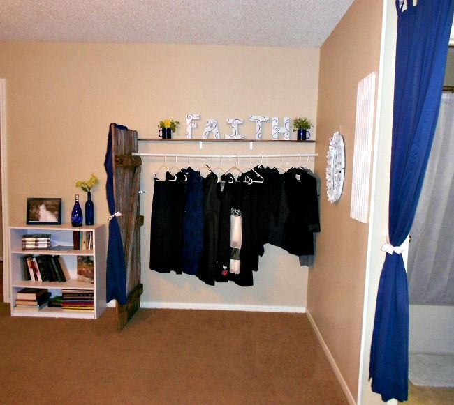 Re-purposed fencing, upcycled into a wardrobe/changing area!