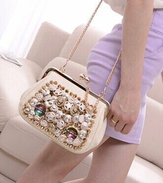 Party Women's Evening Bag With Rhinestone and Rivets Design Color: WHITE, BLACK Category: Bags > Women's Handbags > Evening Bags   Handbag Type: Evening Bag  Style: Fashion  Gender: Women  Embellishment: Rivet  Pattern Type: Solid  Handbag Size: Small(20-30cm)  Closure Type: Hasp  Interior: Interior Zipper Pocket  Occasion: Party  Main Material: PU  Hardness: Hard  #eveningbagsandclutches #eveningbags #fashionbags #womenbags #bridgat.com