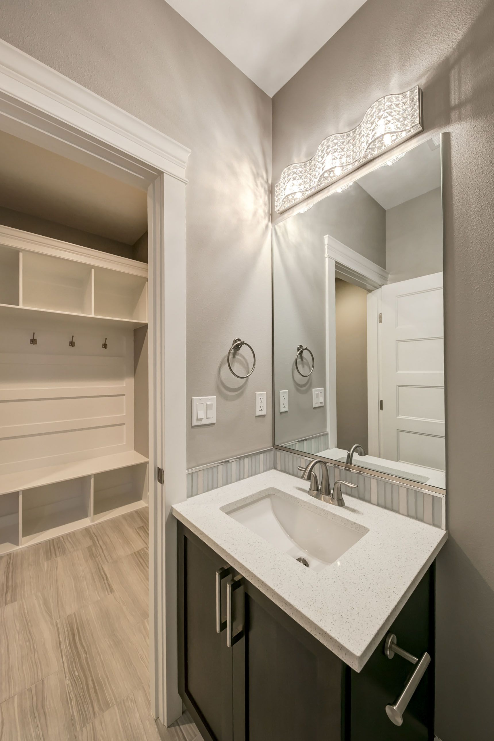 High Quality Elegant Powder Bath From Prodigy Homes. Sparkling Vanity Light, White  Quartz Countertop, And