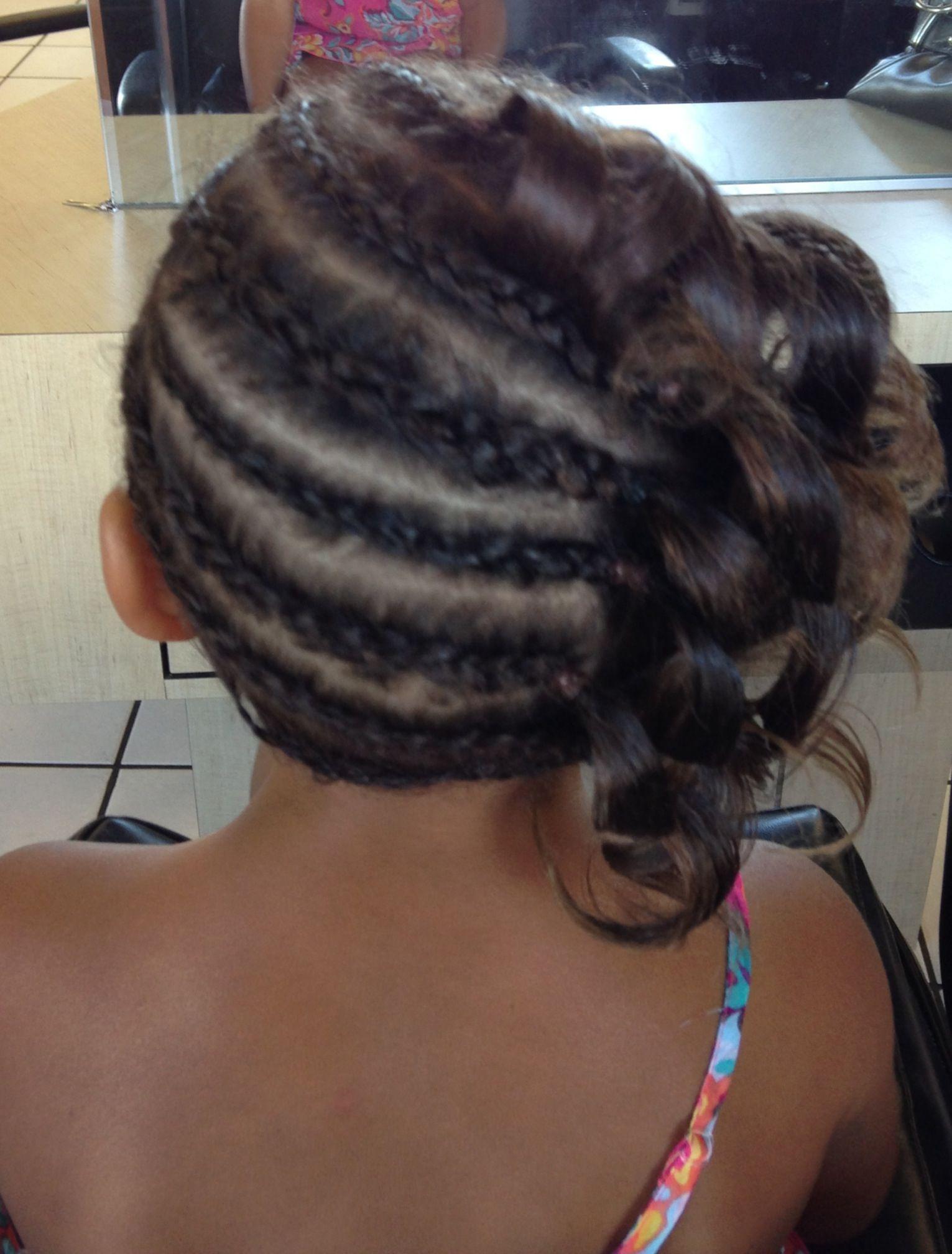 Close up bi racial braids and hot iron curls