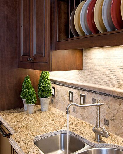 tumbled travertine backsplash traditional kitchen by in detail interiors with images on kitchen interior tiles id=70529