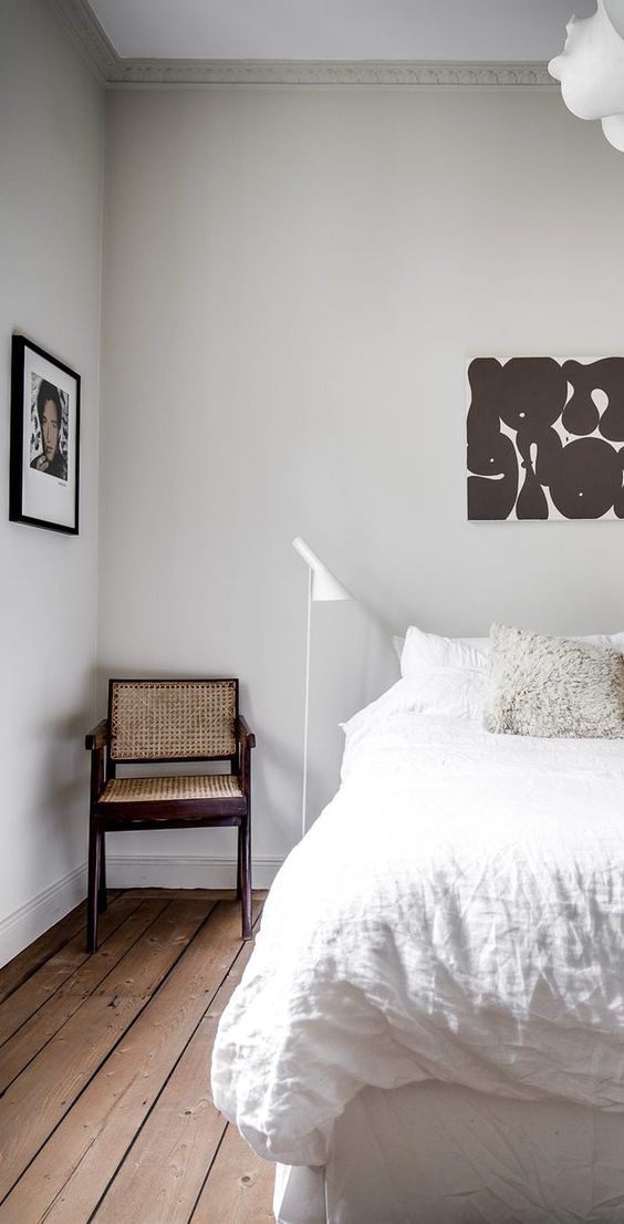a mid-century design chair fitting perfectly in a minimal bedroom