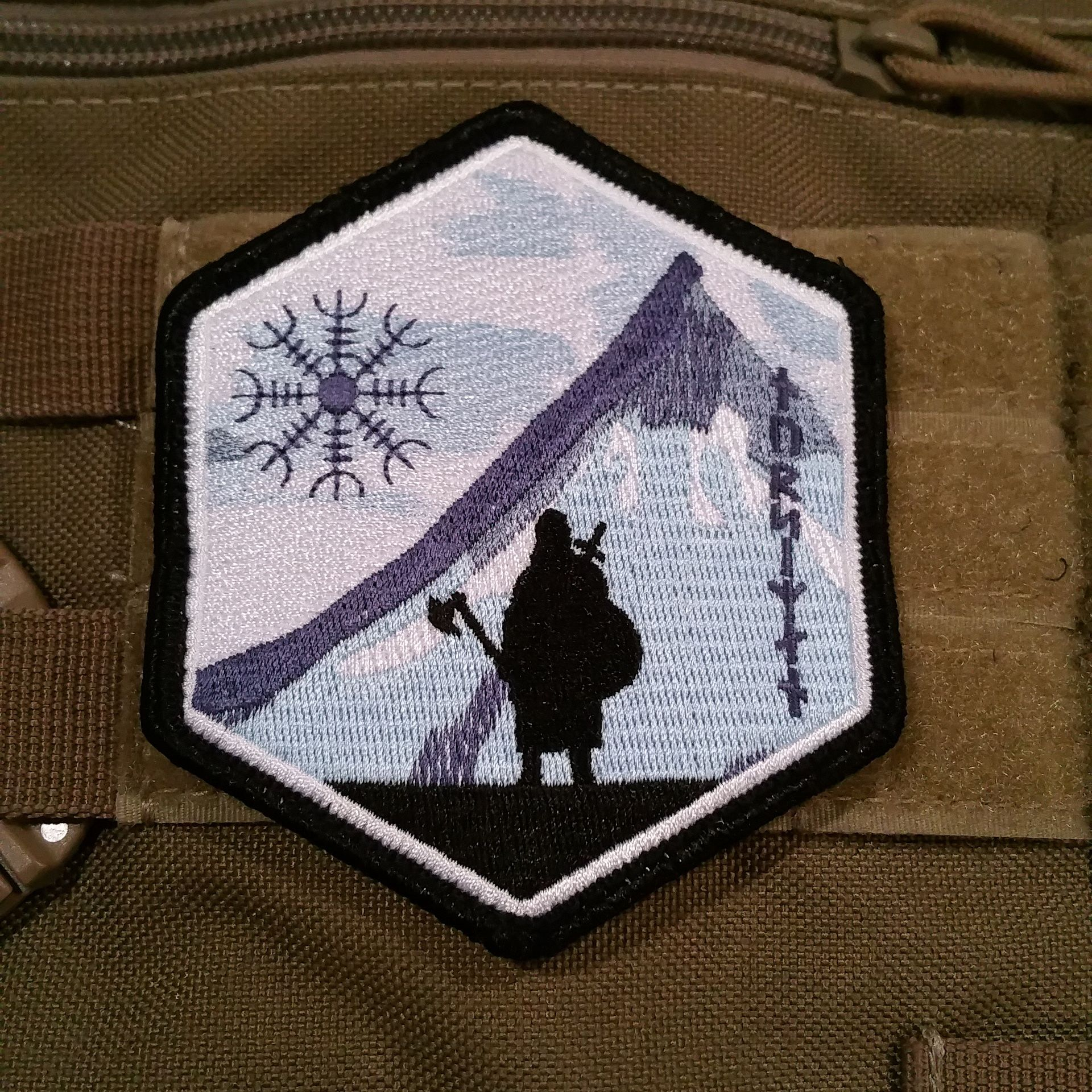 Norseman Morale Patch Version 1, 100% embroidered 4″ x 3″ hexagon shape, features our lone Viking Warrior against a snow covered mountain with the Helm of Awe in the sky. Only 100 made in this limited edition. Made in USA!! Free USPS First Class Shipping!!