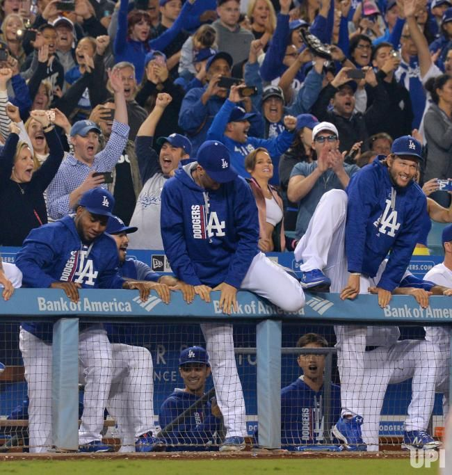 Los Angeles Dodgers  pitcher Clayton Kershaw (R) joins his teammates as  they climb 2efe522efa3