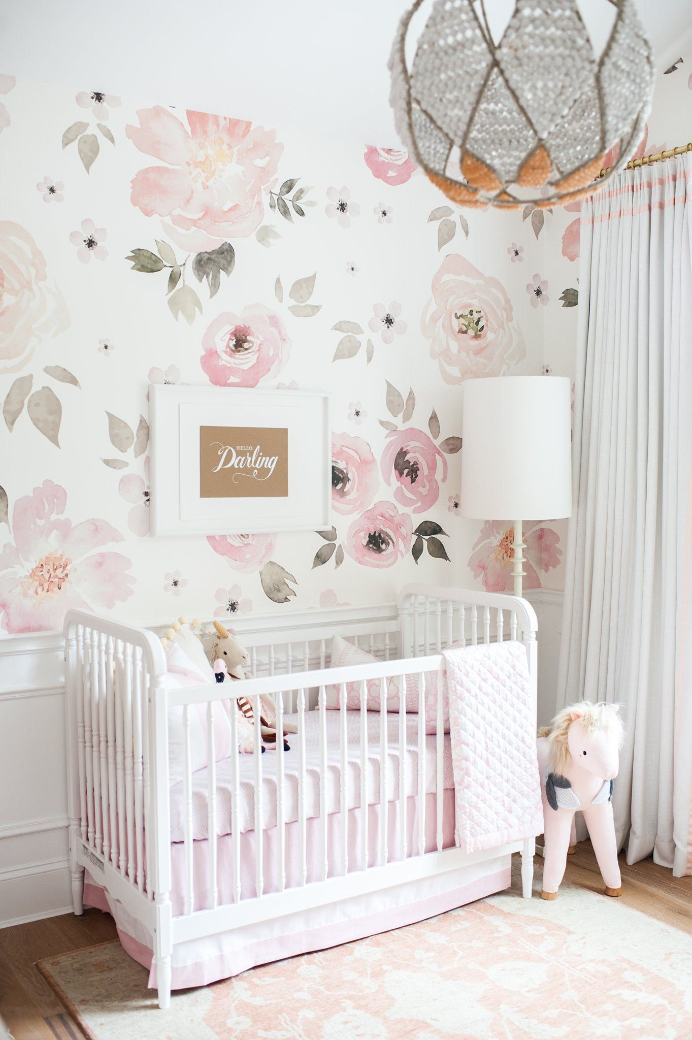 blush pink, white and sage green floral nursery with faux