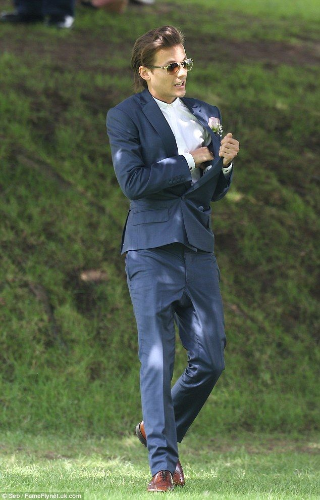 c3dad8ebeb0 Louis Tomlinson looked handsome at his mother s wedding in a navy suit  which he teamed with