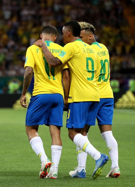Philippe Coutinho Photos - Philippe Coutinho of Brazil celebrates with  Gabriel Jesus and Neymar Jr after scoring his team s first goal during the  2018 FIFA ... 40b22ff1f9510