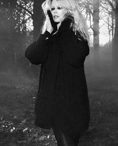 Claudia Schiffer models her new knitwear range. Cashmere oversized cardi-coat, £1,150