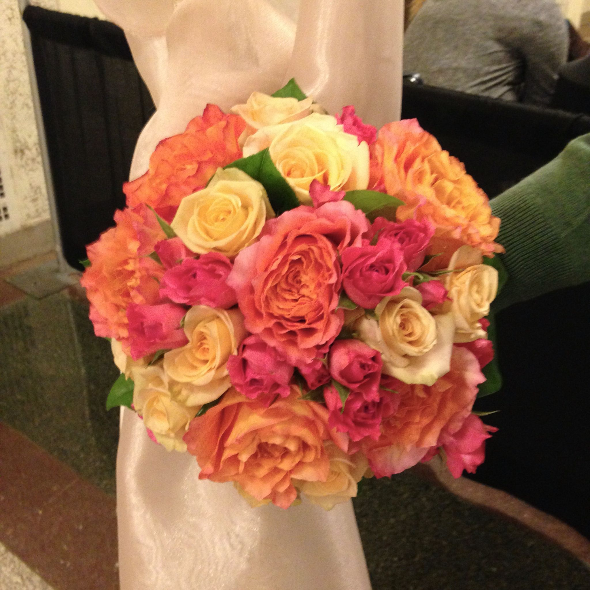 Bridal bouquet oranges , peaches and hot pink. Featuring
