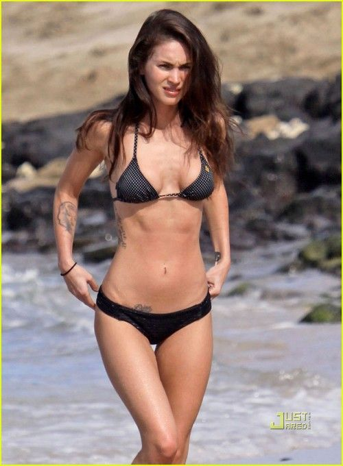 With her voluptuous body and Dark brown hairtype without bra (cup size 34C) on the beach in bikini