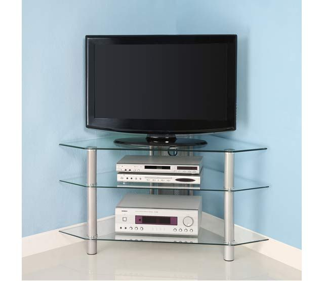 """44"""" Corner TV Stand, Silver - This contemporary TV stand offers a stylish, modern design crafted from durable, metal tubing and thick, tempered safety glass. Three levels of shelving provides ample storage space for a variety of A/V components and media accessories. An ideal space-saving corner design with style, this unit accommodates most TVs up to 48 in. All glass shelves are securely fastened offering solid construction without compromising style."""