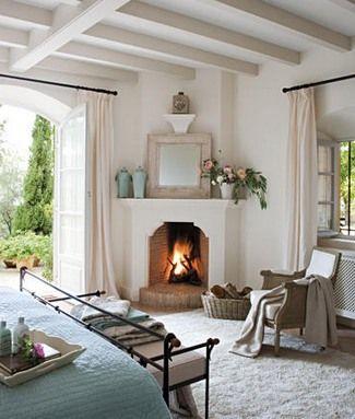 Village bedroom corner fireplace | Cottage fireplace ...