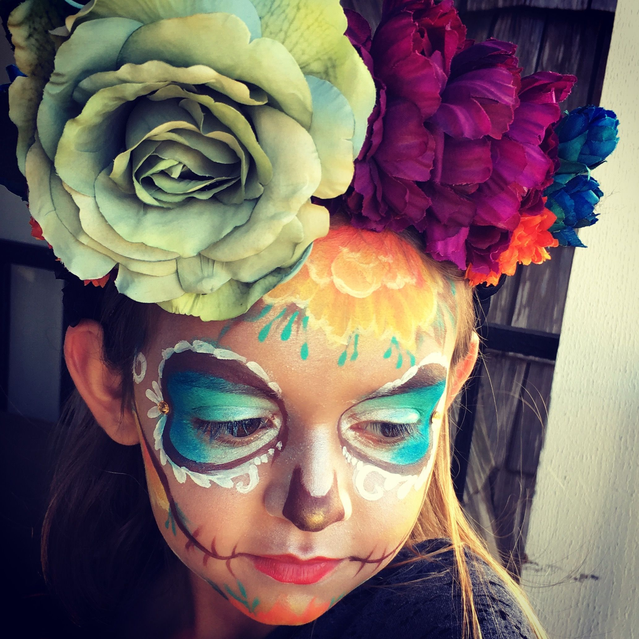 fun colorful day of the dead face painting