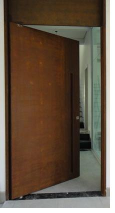 Corten pivot door with integrated flush fitting handle & Fachadas revestimentos e portas pivotantes com a qualidade do Aço ...