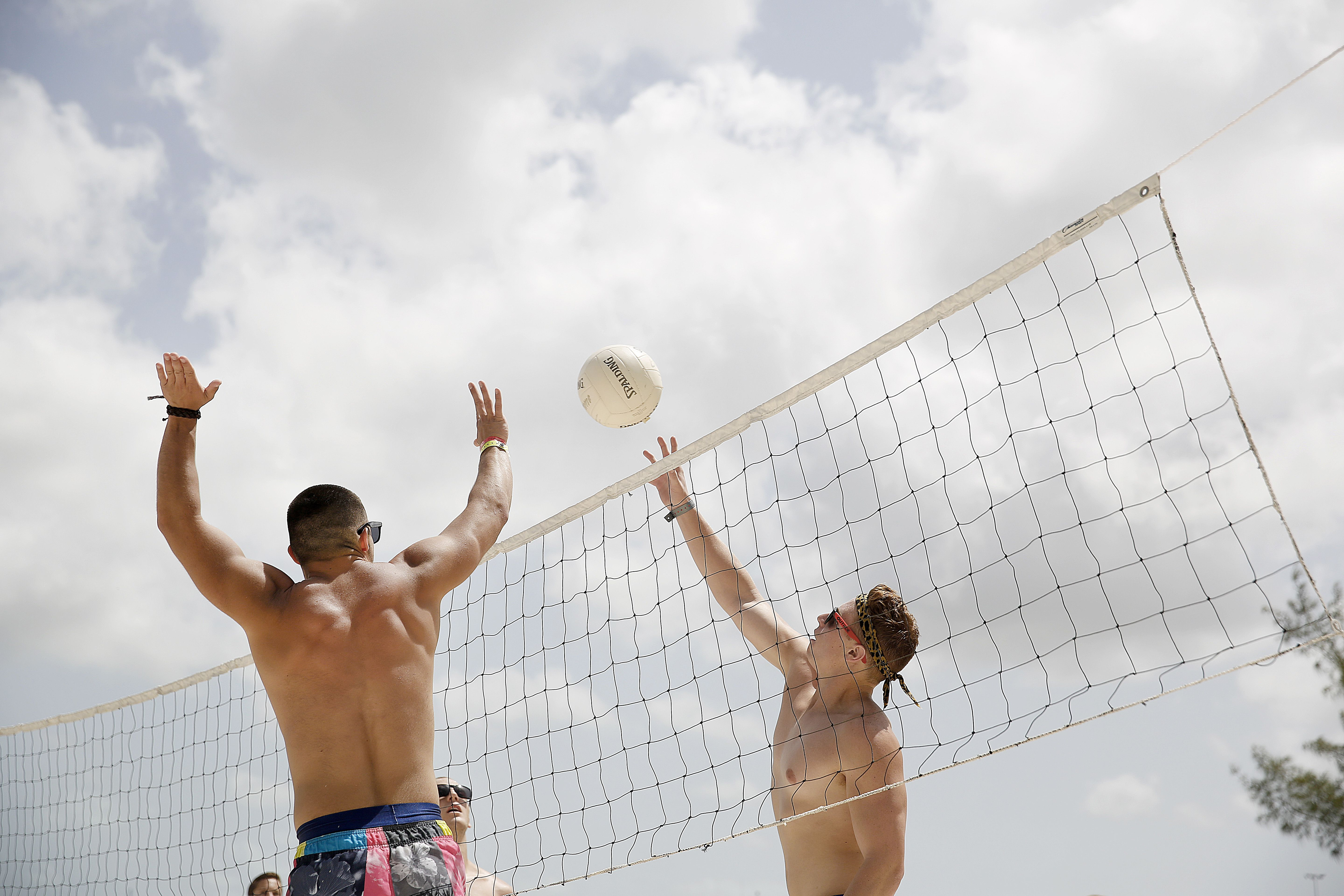 Stay fit on vacation with a game of beach volleyball!
