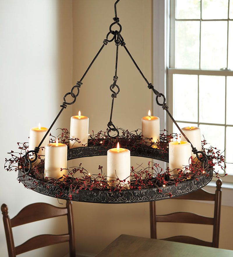 Next year im adding berry garland to my wrought iron chandelier metal hanging candle chandelier and led pillar candles plow amp hearth aloadofball Image collections